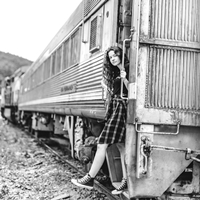 Young woman getting off freight train